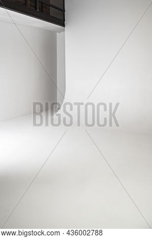 Abstract Empty White Photo Studio Interior Background. Vertical Photo Of Cyclorama Structure With Sm