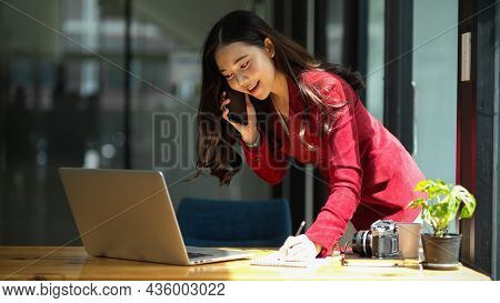 Businesswoman On A Phone Call. Takes Orders From Business Customer
