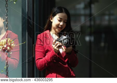 Young Asian Woman Holding Retro Camera