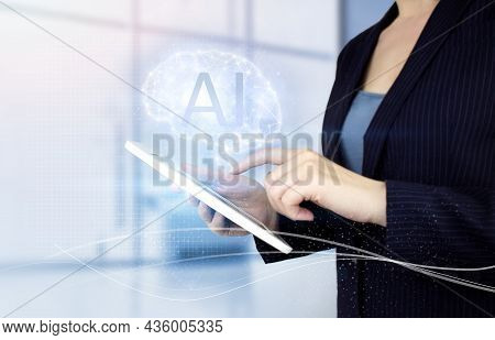 Artificial Intelligence Industry 4.0. Hand Touch White Tablet With Digital Hologram Brain Sign On Li