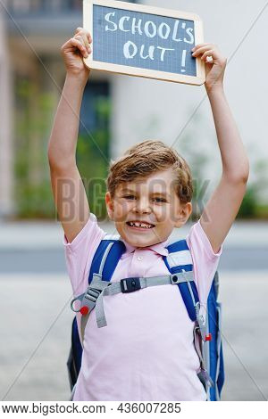 Happy Little Kid Boy With Backpack Or Satchel. Schoolkid On The Way To School. Healthy Adorable Chil