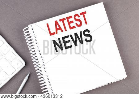 Latest News Text On Notebook With Calculator And Pen