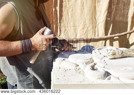Craftsman Carving Stone In A Traditional Way. Concept Of Traditional And Manual Work