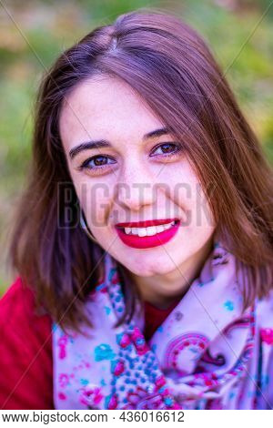 Girl In Red Sweater In Nature. Girl In Red In Nature. Girl With Red Lips. Autumn Photo