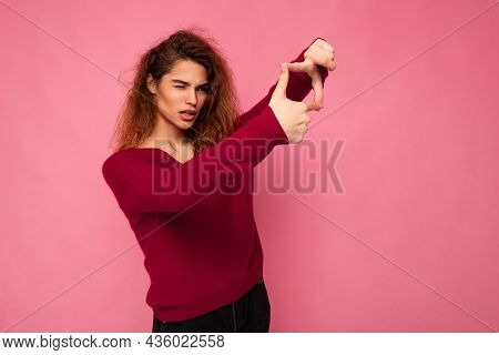 Portrait Of Young Positive Pretty Brunette Curly Woman With Sincere Emotions Wearing Trendy Pink Swe