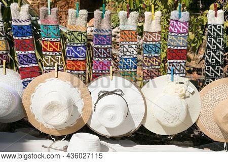 Alanya , Turkey- October 20, 2020:  Colorful handmade woollen socks and hats displayed in the streetmarket in Alanya, Turkey.