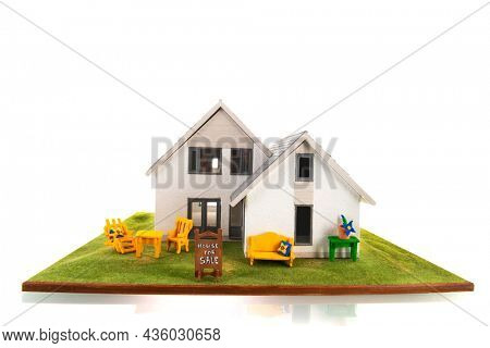 Miniature house for sale isolated over white background