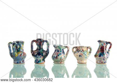 Pottery vases in many colors isolated over white background