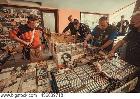 Montebelluna, Italy: Music Market Customers Browsing Through Vintage Vinyl Records And Second Hand L