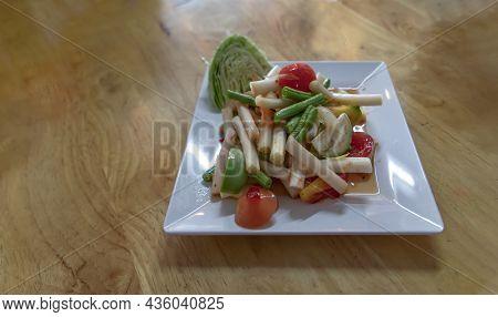 Lotus Stem Thai Spicy Salad On Wooden Table. Thai Som Tum With Lotus Stem Is Popular Thai Local Styl