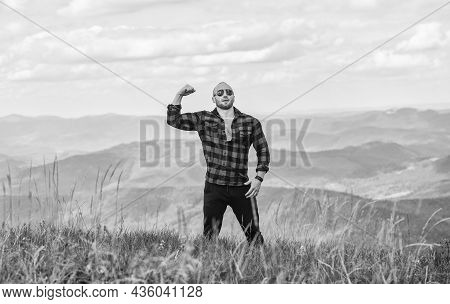 Power Of Nature. Man Stand On Top Of Mountain Landscape Background. Natural Power. Masculine Power.