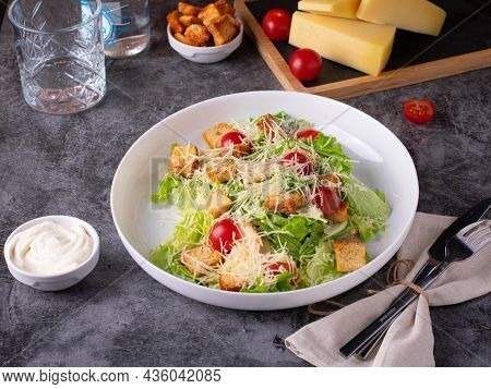 Caesar Salad With Chicken, Parmesan And Wheat Croutons On A Vintage Grey Background. Light Diet Dinn