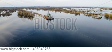 Aerial View Of Dredge Replenish Sand In River. Canal Is Being Dredged By Excavator. Top View Of Dred