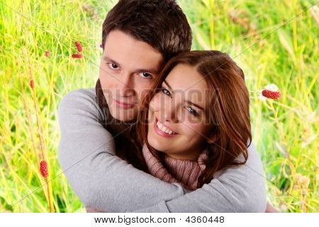 Attractive Couple In Love Smiling And Hugging In Nature