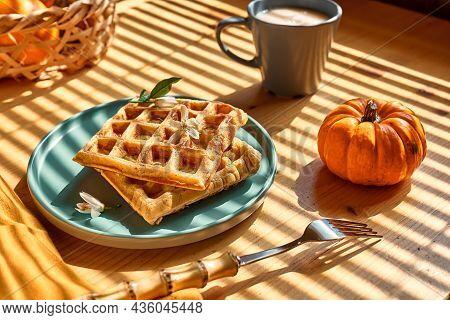 Healthy Autumn Breakfast. Pumpkin Spice Belgian Waffles With Orange Honey On Light Blue Plate On Woo