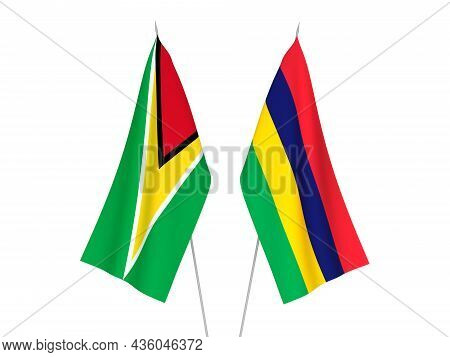 National Fabric Flags Of Republic Of Mauritius And Co-operative Republic Of Guyana Isolated On White