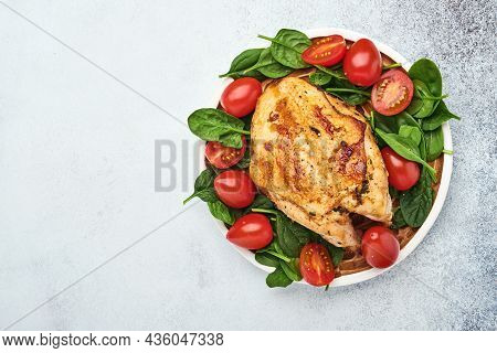 Grilled Chicken Breast With Spinach Green Salad, Pepper And Cherry Tomatoes In A Ceramic Plate At Wh