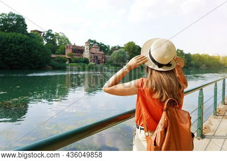Traveler Girl Holding Her Hat Discovering Hidden Castle In The Park. Young Woman Relaxing And Breath