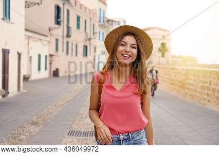 Cheerful Traveler Girl Walking Towards The Camera On Street In Old Town