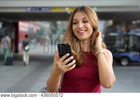 Charming Beautiful Business Woman Smile Holds Smartphone Walking In Train Or Metro Station