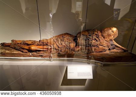Turin, Italy - August 19, 2021: Mummy In A Lying Position. Mummification Of One Body During The Egyp
