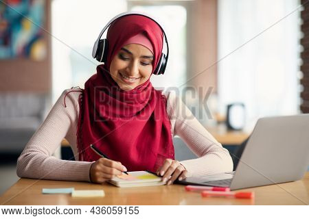 Smiling Middle-eastern Woman Having Online Training, Cafe Interior