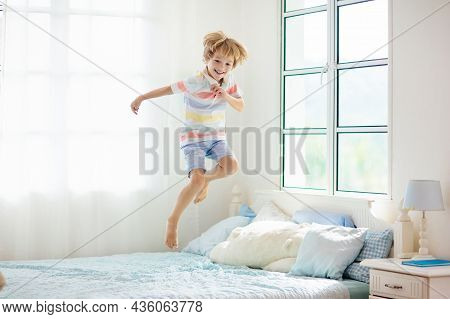 Child Playing In Bed. Kids Room. Boy At Home.
