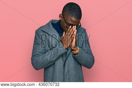 Young african american man wearing business clothes and glasses rubbing eyes for fatigue and headache, sleepy and tired expression. vision problem