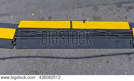 Electric Cables Protection Device At Street Crossing