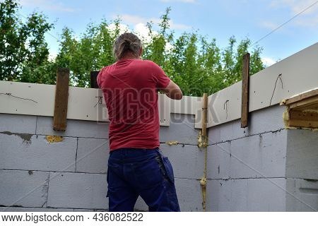 The Bricklayer Is Preparing To Concreting The Walls On The Construction Site