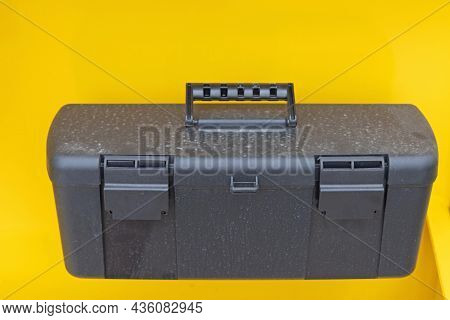 Plastic Toolbox Attach To Yellow Construction Machine