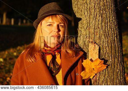 Portrait Of Pretty Caucasian Blonde Woman In Colorful Dark Maple Autumn Park. Bright Stylish Woman I