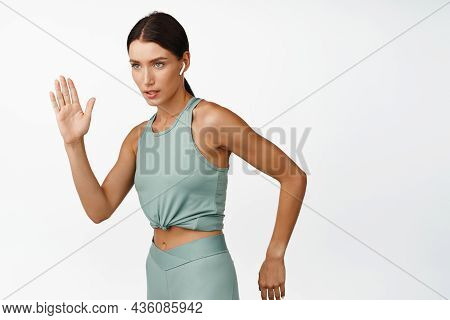 Confident Sportswoman Running. Female Jogger Run, Motion Photo, Looking At Goal Determined, Standing