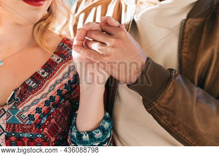 Intertwined And United Hands Of A Couple In Love. Concept Of Carefreeness, Relationships, Passion, T
