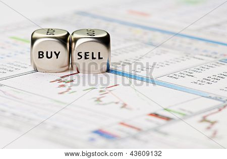 Dices Cubes With The Words Sell Buy On Financial Downtrend Chart Graph. Selective Focus