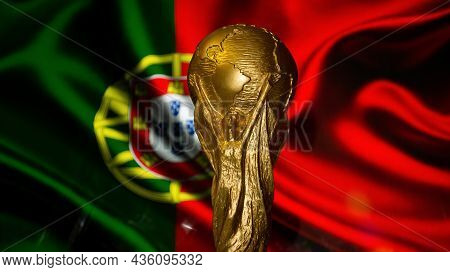 October 6, 2021 Lisbon, Portugal. Fifa World Cup Cup Against The Background Of The Flag Of Portugal.