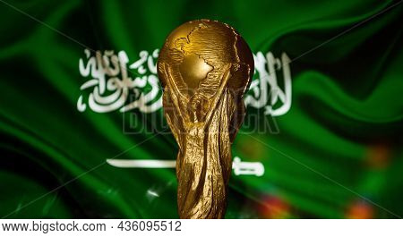 6 October 2021 Riyadh, Saudi Arabia. Fifa World Cup Cup Against The Background Of The Flag Of Saudi