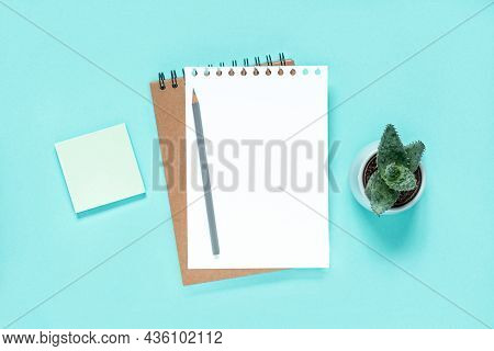 Notebook With Pencil. School Notebook On Light Blue Background, Spiral Notepad On Table. Top View Of