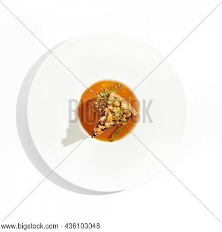 Nuts tart isolated on white background. Sweet pie with nuts and caramel sauce. Dessert with praline, chocolate and cashew, hazelnut, peanut and caramel sauce. Toffee nut pie in restaurant menu