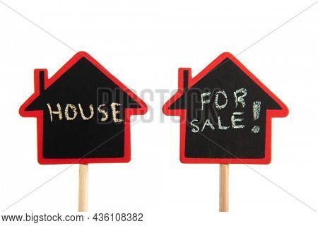 Little house for sale black board on stick isolated over white background