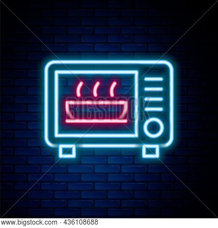 Glowing Neon Line Microwave Oven Icon Isolated On Brick Wall Background. Home Appliances Icon. Color