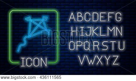 Glowing Neon Kite Icon Isolated On Brick Wall Background. Neon Light Alphabet. Vector