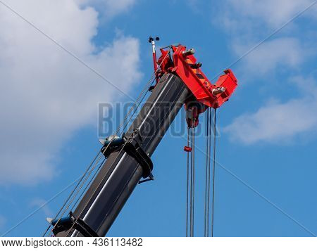 Telescopic Boom Of A Mobile Crane Against A Cloudy Sky, Close-up. Construction And Repair Equipment