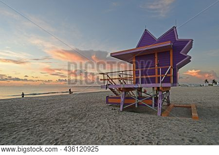 Colorful Lifeguard Station On Miami Beach, Florida Under Late Summer Cloudscape In Early Morning Lig