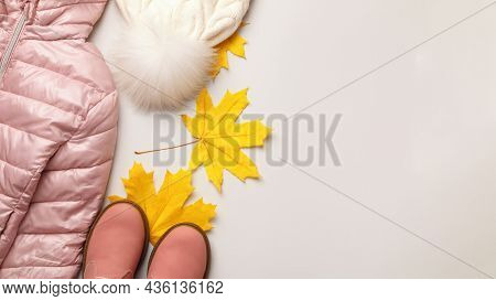 A Set Of Warm Autumn-winter Clothes For A Girl On A Light Gray Background. Jacket Hat Shoes. Flat La
