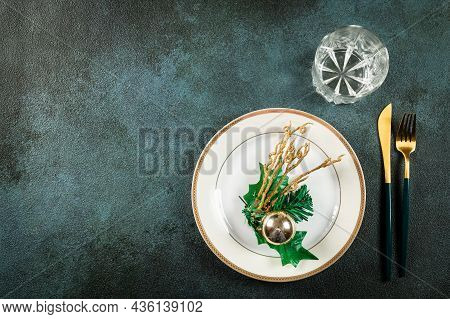 Christmas Table Setting With Modern Dishware And Decorations On Dark Background. Top View. New Year