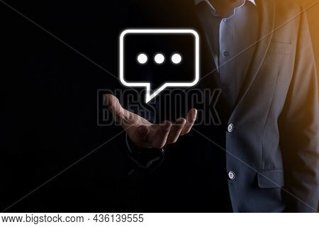 Businessman Holding A Message Icon, Bubble Talk Notification Sign In His Hands. Chat Icon, Sms Icon,