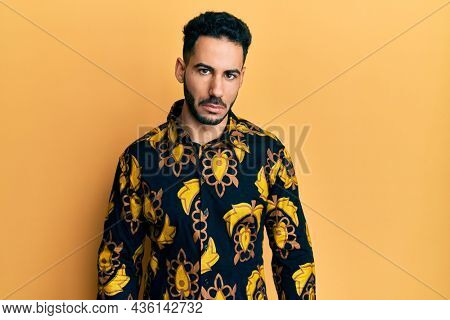 Young hispanic man wearing casual shirt depressed and worry for distress, crying angry and afraid. sad expression.