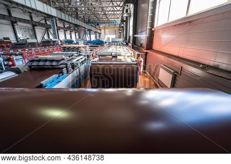 Metalworking Forming Machine And Roof Tile Production Line With Conveyor Belt In Modern Factory Work