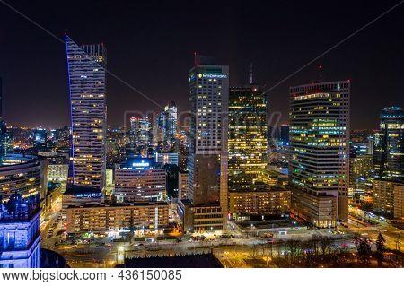 Warszawa, Poland - February 25, 2021: Beautiful architecture of Warszawa city center with modern skyscrapers at night, Poland.